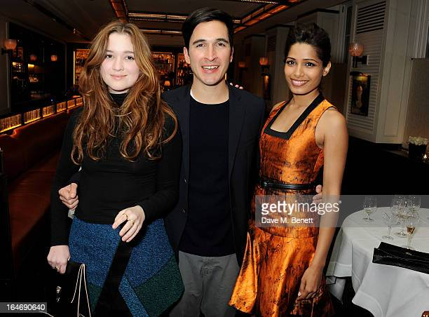 Alice Englert Lazaro Hernandez and Freida Pinto attend a dinner hosted by online luxury fashion retailer NETAPORTER to celebrate designers Jack...