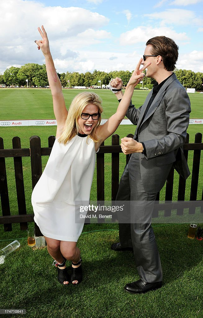 Alice Eve (L) and brother Jack Eve attend the Audi International Polo at Guards Polo Club on July 28, 2013 in Egham, England.