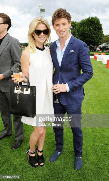 Alice Eve and Eddie Redmayne attend the Audi International Polo at Guards Polo Club on July 28 2013 in Egham England