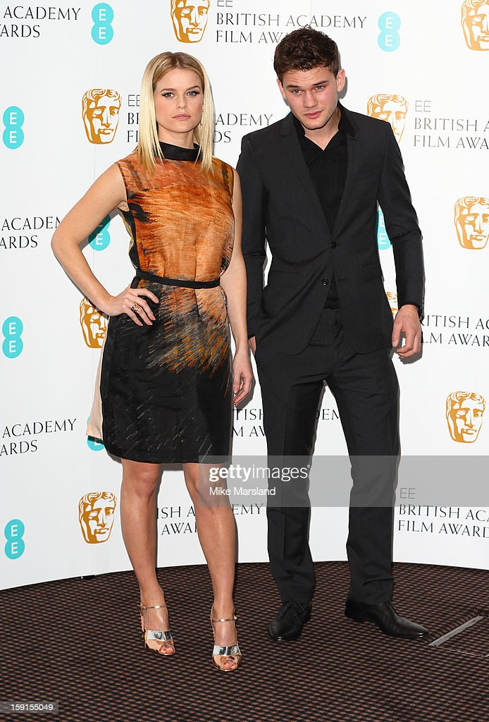 Alice Eve and Jeremy Irvine attend as the nominations for the EE British Academy Film Awards are announced on January 9, 2013 in London, England.
