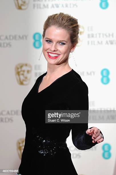 Alice Eve poses in the winners room at the EE British Academy Film Awards at The Royal Opera House on February 8 2015 in London England