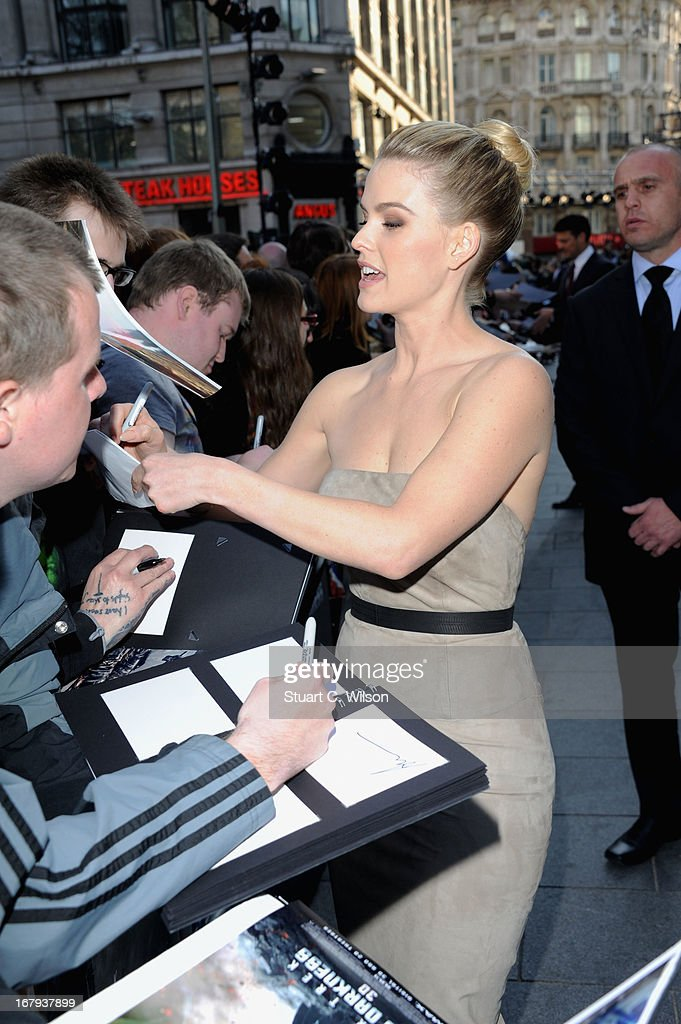 Alice Eve signs autographs at the UK Premiere of 'Star Trek Into Darkness' at The Empire Cinema on May 2, 2013 in London, England.