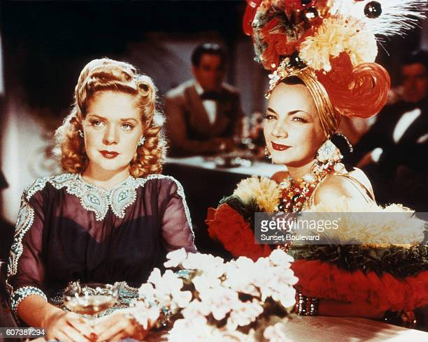Alice Faye and Carmen Miranda on the movie set of That Night in Rio directed by Irving Cummings