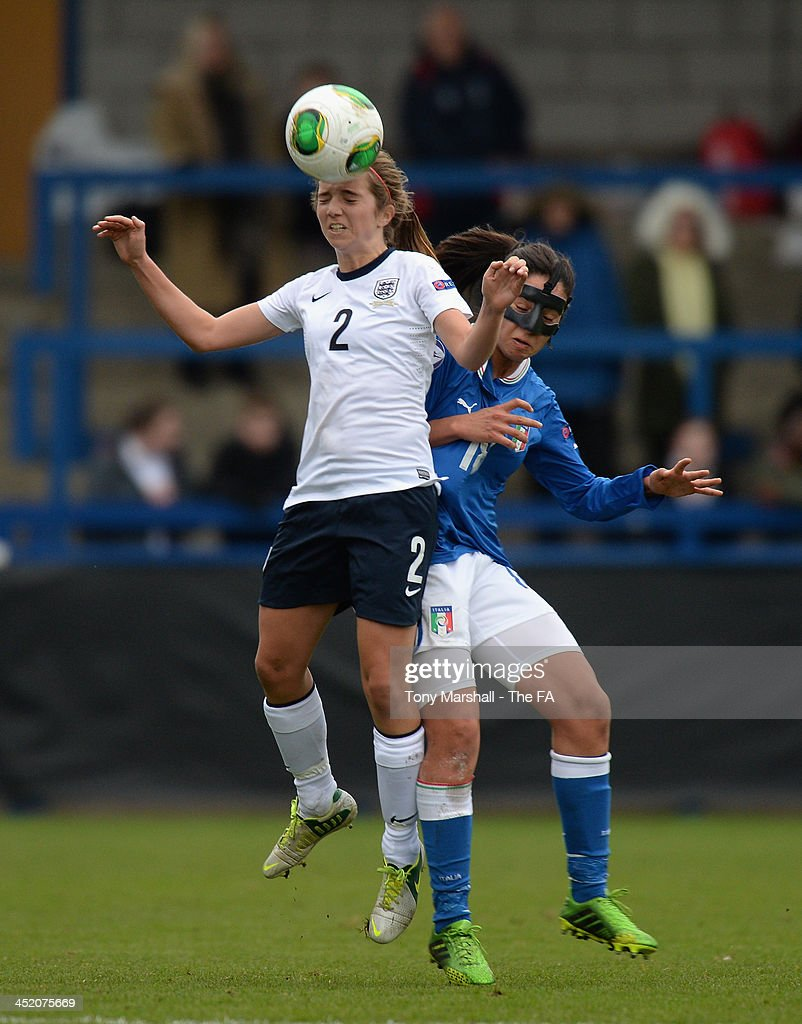 Alice Hassall of Englang tackled by Martina Piedmonte of Italy during the UEFA Womens U17 Championship Finals match between England and Italy at the AFC Telford New Bucks Head Stadium on November 26, 2013 in Telford, England.