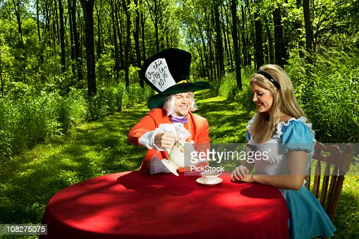 Mad Hatter and Alice in Wonderland Having Tea Party