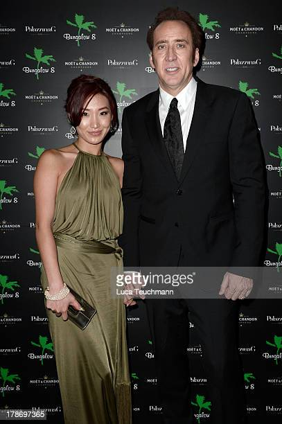 Alice Kim and actor Nicolas Cage attend 'Bungalow 8 Pop Up at theVenice Film Festival' during the 70th Venice International Film Festival at...