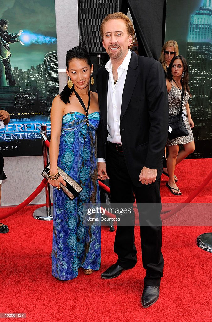 <a gi-track='captionPersonalityLinkClicked' href=/galleries/search?phrase=Alice+Kim&family=editorial&specificpeople=212731 ng-click='$event.stopPropagation()'>Alice Kim</a> and actor <a gi-track='captionPersonalityLinkClicked' href=/galleries/search?phrase=Nicolas+Cage&family=editorial&specificpeople=196531 ng-click='$event.stopPropagation()'>Nicolas Cage</a> pose for a photo on the red carpet at the premiere of 'The Sorcerer's Apprentice' at the New Amsterdam Theatre on July 6, 2010 in New York City.