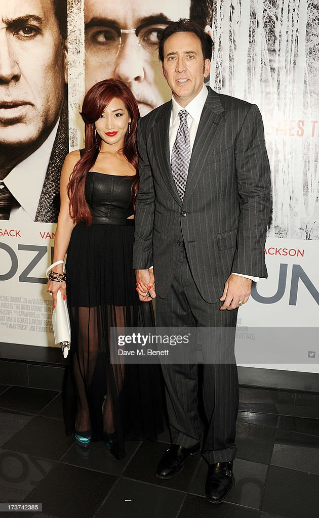 Alice Kim (L) and Nicolas Cage attend the UK Premiere of 'The Frozen Ground' at Vue West End on July 17, 2013 in London, England.