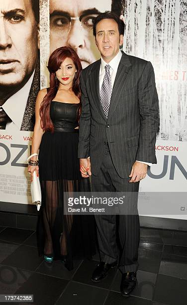 Alice Kim and Nicolas Cage attend the UK Premiere of 'The Frozen Ground' at Vue West End on July 17 2013 in London England