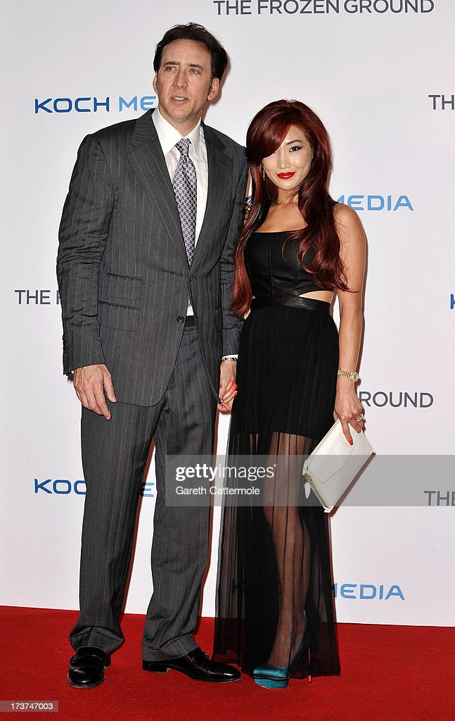 Alice Kim and Nicolas Cage attend the UK Premiere of 'The Frozen Ground' at Vue West End on July 17, 2013 in London, England.