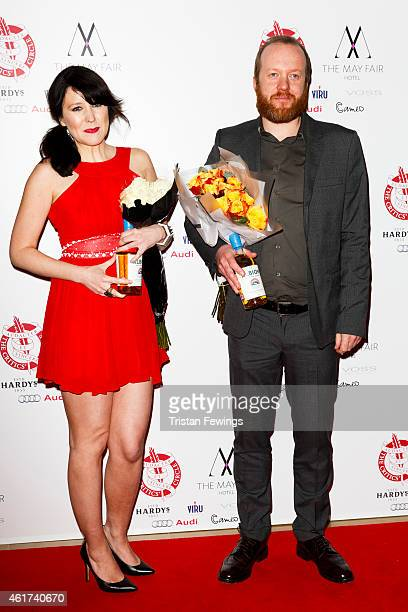 Alice Lowe and Steve Oram pose in the Winners Room at The London Critics' Circle Film Awards at The Mayfair Hotel on January 18 2015 in London England