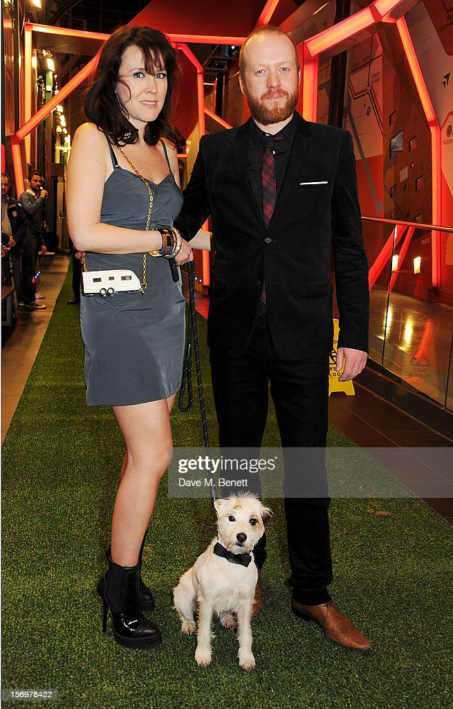 Alice Lowe (L) and Steve Oram pose with Smurf the dog at the UK Premiere of 'Sightseers' in association with Stella Artois at the London Transport Museum on November 26, 2012 in London, England.
