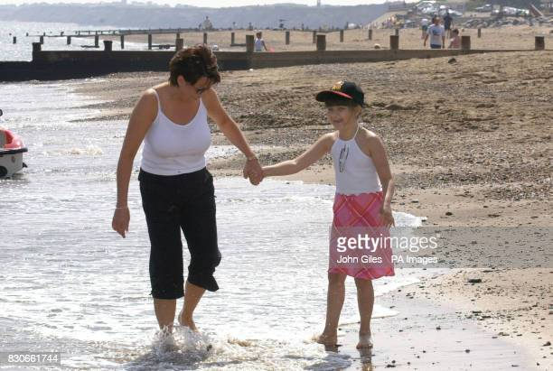 Alice Maddocks from Hanging Heaton West Yorkshire who suffers from aplastic anaemia and her mother carol enjoy the beach on holiday in Hornsea East...
