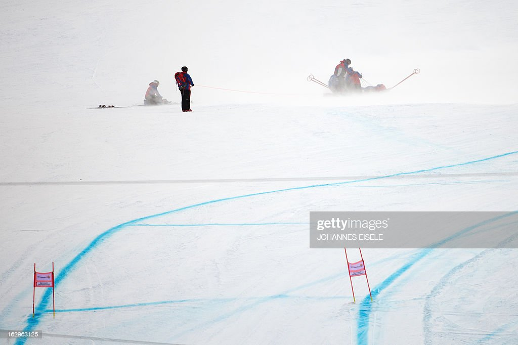 US Alice Mckennis is rescued after she fell during the FIS World Cup Women's Downhill in Garmisch-Partenkirchen, southern Germany, on March 2, 2013. AFP PHOTO / JOHANNES EISELE