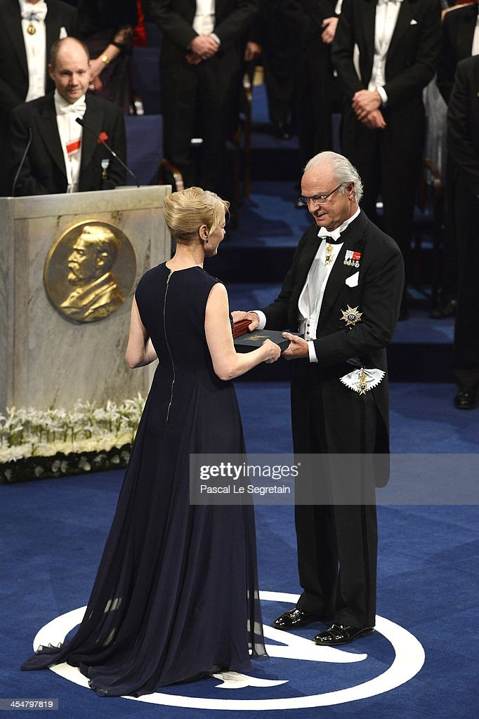 Alice Munro, laureate of the Nobel Prize in Literature, represented by her daughter Jenny Munro (L) receives her Nobel Prize from King Carl XVI Gustaf of Sweden (R) during the Nobel Prize Awards Ceremony at Concert Hall on December 10, 2013 in Stockholm, Sweden.