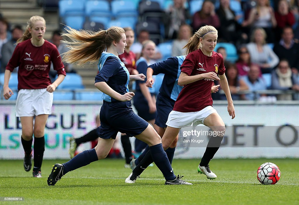 Alice Nichols of Kings' School battles with Erin Deakin of St Bede's School controls the ball during the Premier League U16 Schools Cup For Girls final between St Bede's School and Kings' School at the Etihad Campus on May 06, 2016 in Manchester, England.