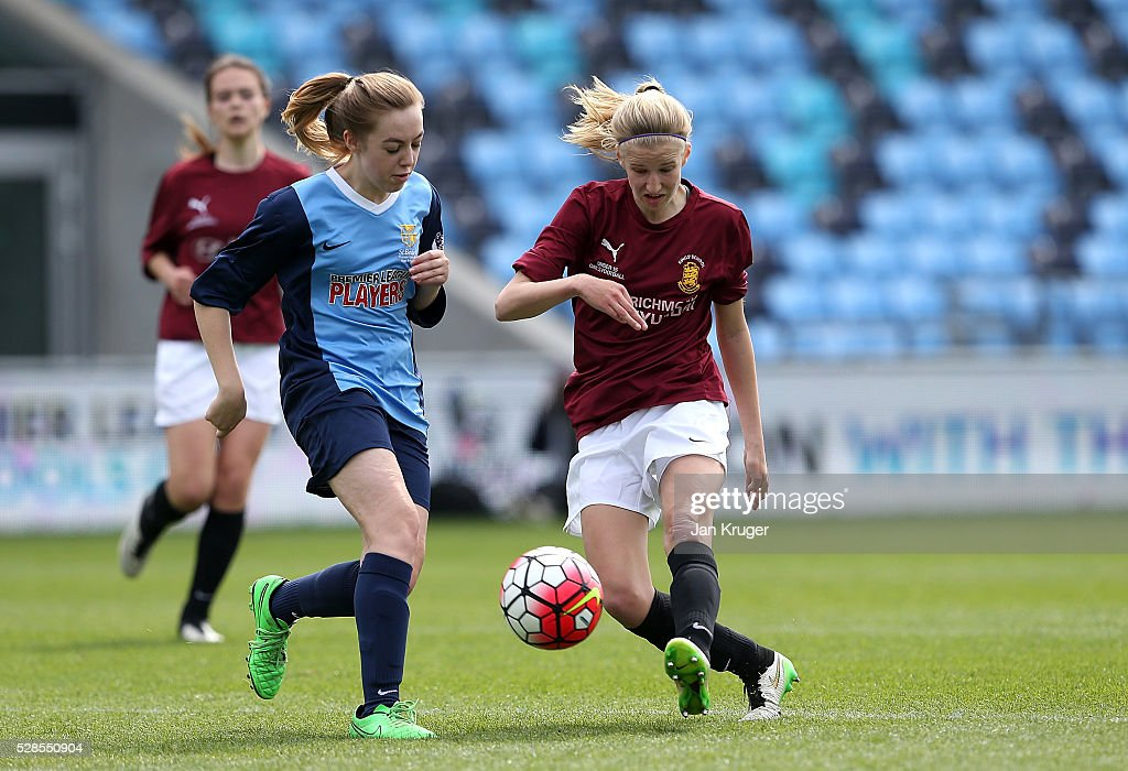 Alice Nichols of Kings' School shoots at goal under pressure from Megan Horricks of St Bede's School during the Premier League U16 Schools Cup For Girls final between St Bede's School and Kings' School at the Etihad Campus on May 06, 2016 in Manchester, England.