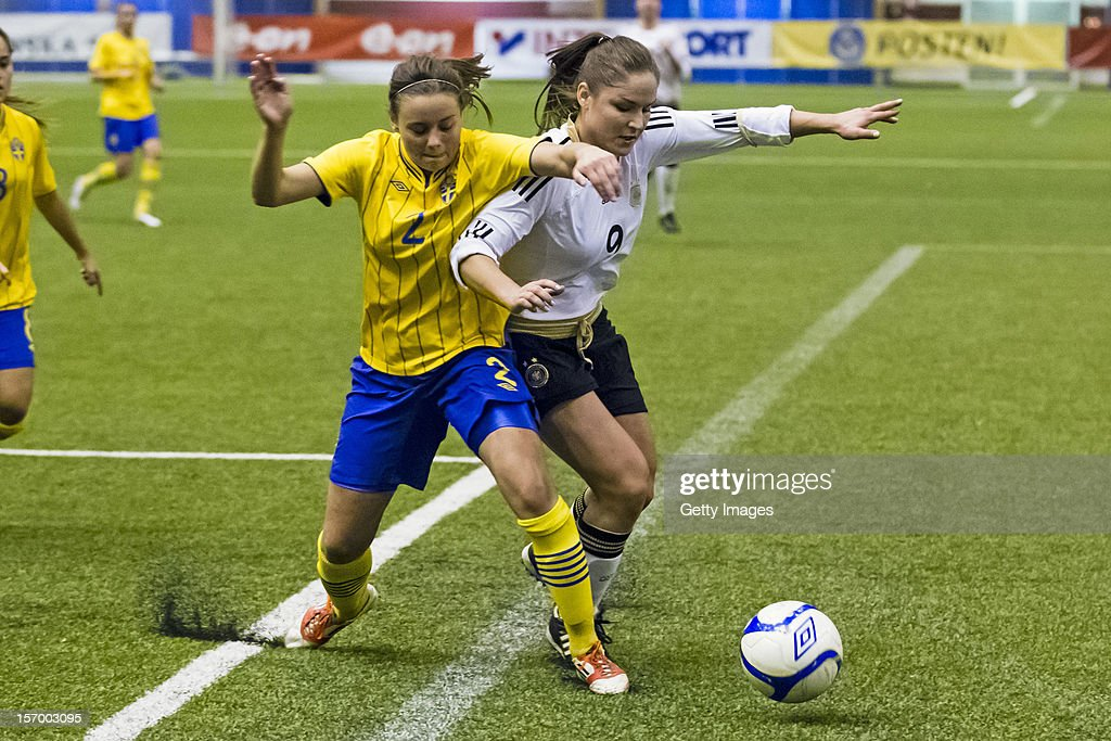 Alice Nilsson of Sweden fights for the ball with Silvana Chojnowski of Germany during the Under 19 Women's international friendly between Sweden and Germany at Tipshallen Stadium on November 21, 2012 in Vaxjo, Sweden.