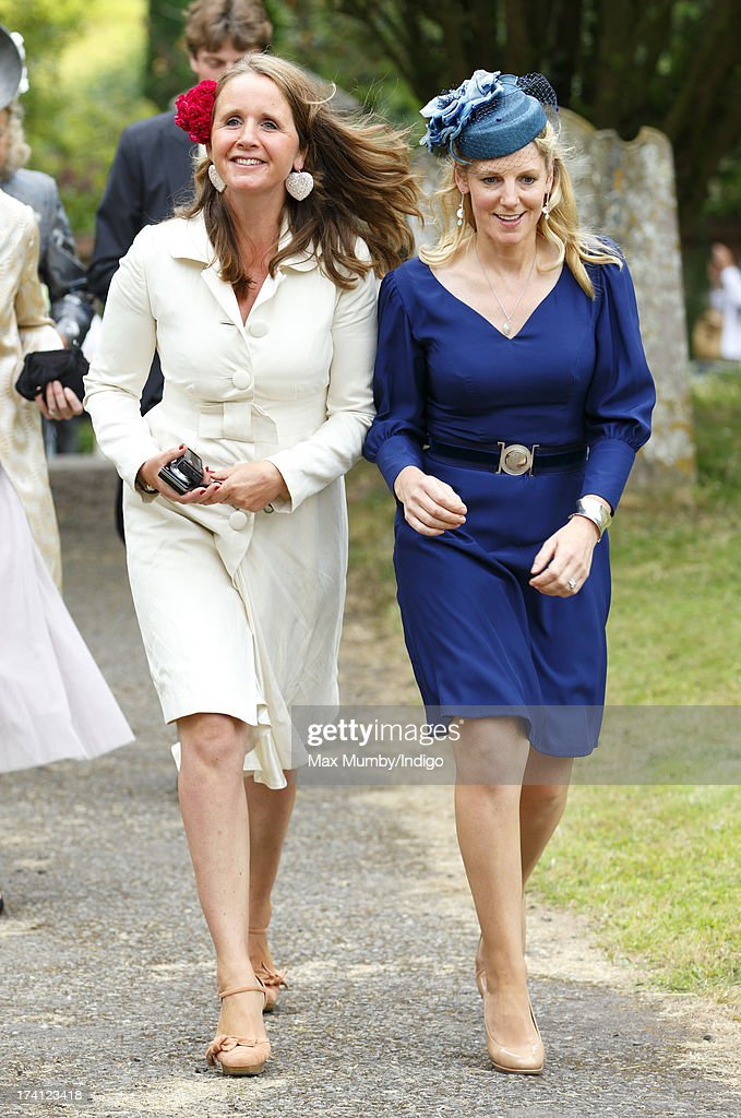 Alice Plunkett (L) attends the wedding of Alicia Fox-Pitt and Sebastian Stoddart at The Church of the Holy Cross in Goodnestone on July 20, 2013 near Dover, England.