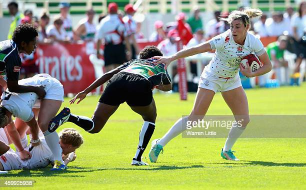 Alice Richardson of England in action against Fiji during the IRB Women's Sevens Rugby World Series at the Emirates Dubai Rugby Sevens at on December...