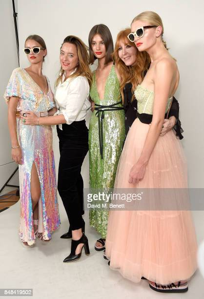 Alice Temperley and Charlotte Tilbury with models backstage at the Temperley London Fashion Show SS 18 during London Fashion Week at The Lindley Hall...