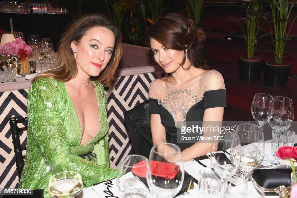 Alice Temperley and Olga Kurylenko during The Fashion Awards 2017 in partnership with Swarovski at Royal Albert Hall on December 4 2017 in London...