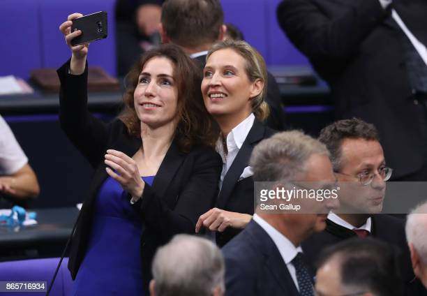 Alice Weidel of the rightwing Alternative for Germany does a selfie with an AfD colleague as they attend the opening session of the new Bundestag on...
