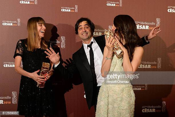 Alice WinocourCharles Gillibert and Deniz Gamze Erguven pose with their awards of Best Script and Best First Feature for the movie 'Mustang' during...