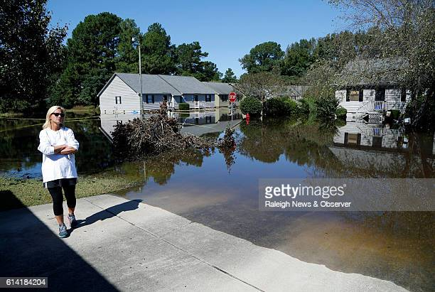 Alicia Corey can only watch as the flood waters rise at the Wyndham Circle duplex complex on Wednesday Oct 12 2016 in Greenville NC She and her...