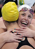 Alicia Coutts and Brittany Elmslie of Australia celebrate after they won the Final of the Women's 4x100m Freestyle Relay on Day 1 of the London 2012...
