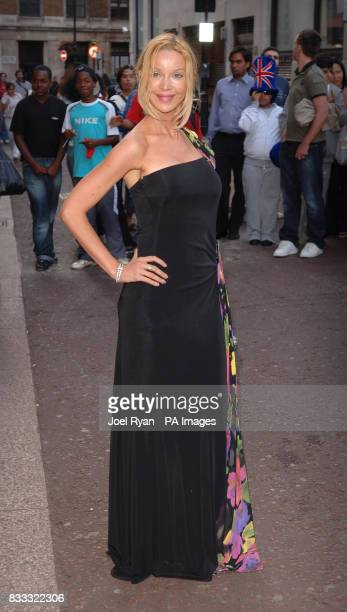 Alicia Duvall arrives for the gala Screening of Top Gun at the Odeon West End in central London
