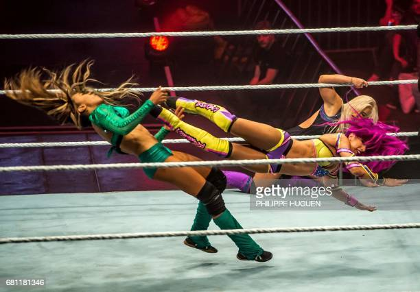 TOPSHOT Alicia Fox and Sasha Bank battle during the WWE show at Zenith Arena on may 09 2017 in Lille north France / AFP PHOTO / PHILIPPE HUGUEN