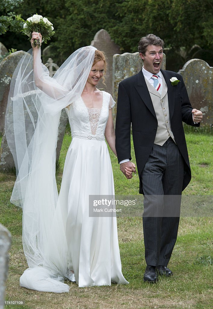 Alicia Fox-Pitt and Sebastian Stoddart after getting married at the Holy Cross church in Goodnestone on July 20, 2013 in Dover, England.