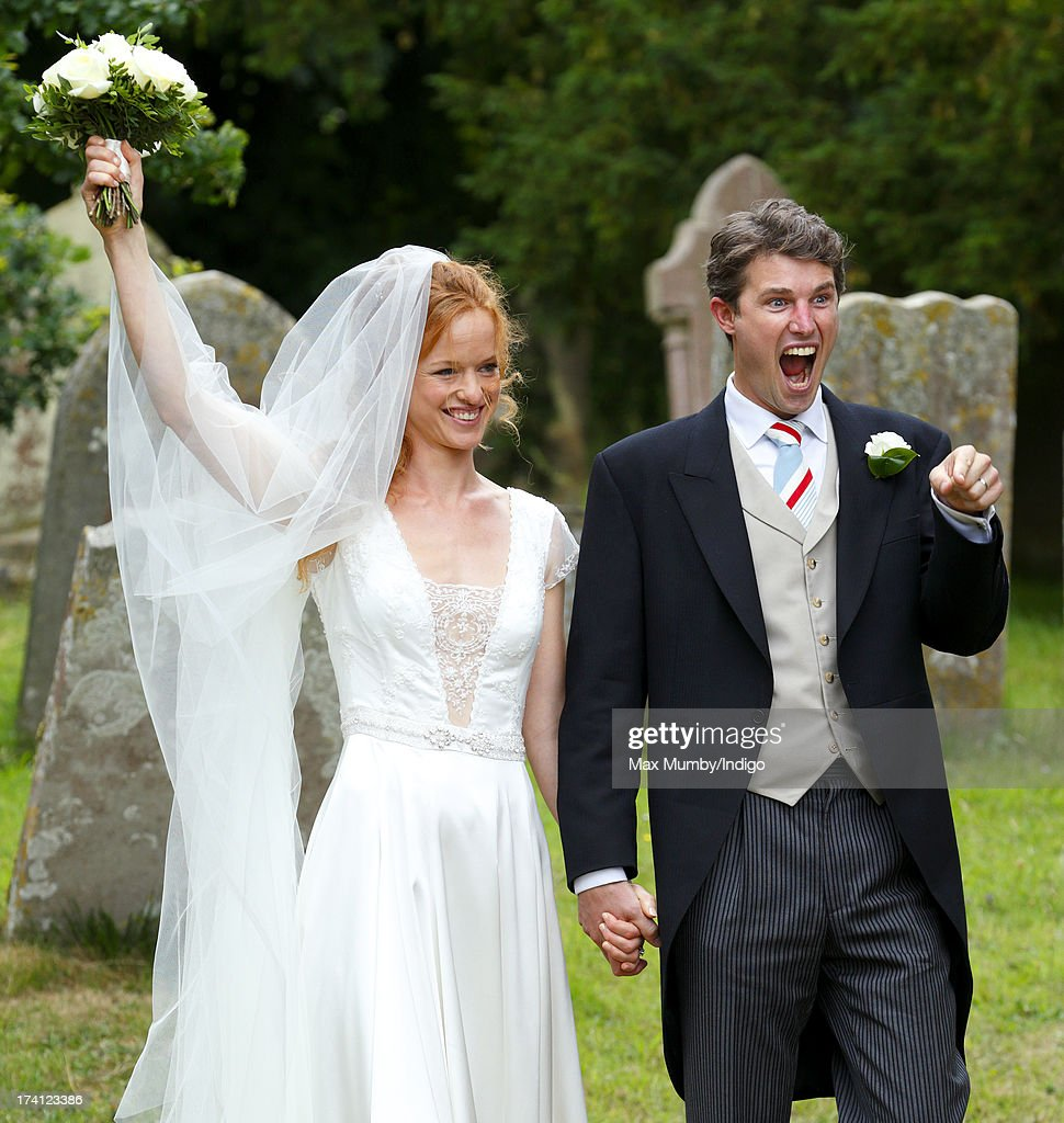 Alicia Fox-Pitt and Sebastian Stoddart leave The Church of the Holy Cross after their wedding in Goodnestone on July 20, 2013 near Dover, England.