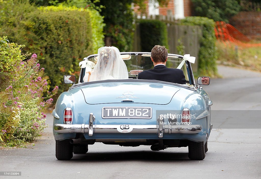 Alicia Fox-Pitt and Sebastian Stoddart leave The Church of the Holy Cross in an open-top Mercedes car after their wedding in Goodnestone on July 20, 2013 near Dover, England.