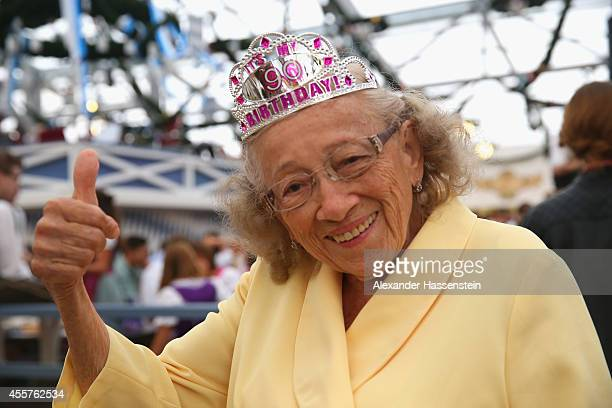 Alicia Garrido from Los Angeles CA celebrates her 90th birthday today at the Schottenhamel beer tent of the opening day for the 2014 Oktoberfest on...