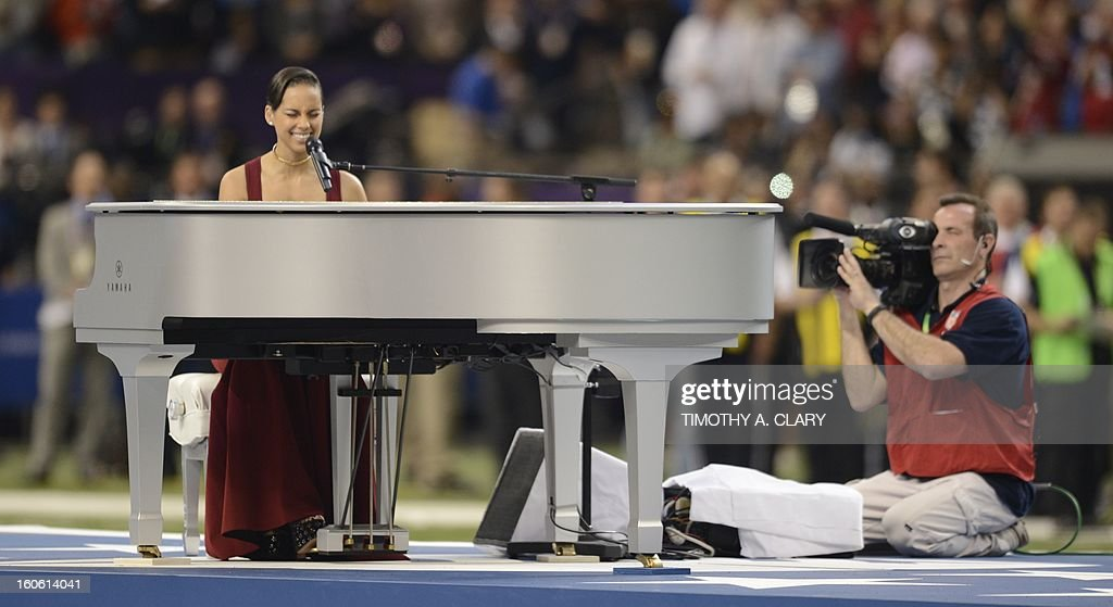 Alicia Keyes performs the Americam National Anthem before the start of Super Bowl XLVII between the San Francisco 49ers and the Baltimore Ravens at the Mercedes-Benz Superdome on February 3, 2013 in New Orleans, Louisiana.