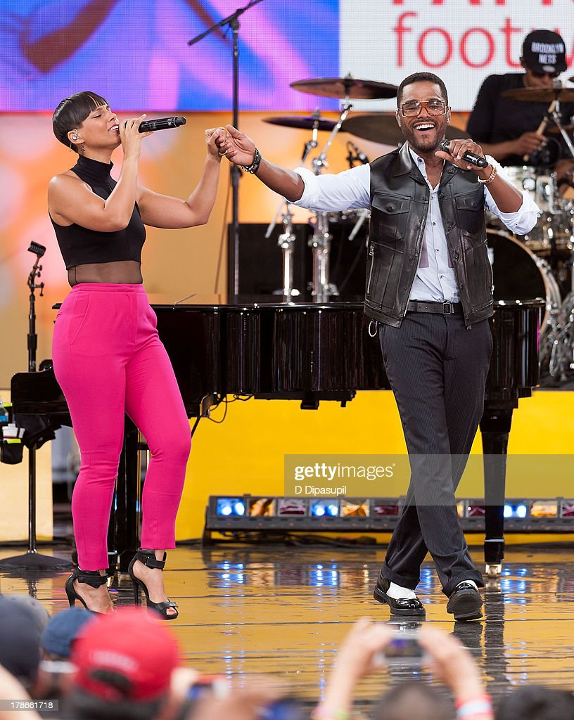 Alicia Keys (L) and Maxwell perform on ABC's 'Good Morning America' at Rumsey Playfield on August 30, 2013 in New York City.