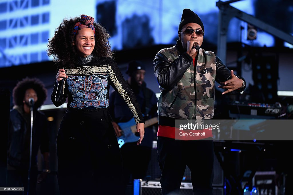 Alicia Keys and Nas perform at Times Square on October 9, 2016 in New York City.