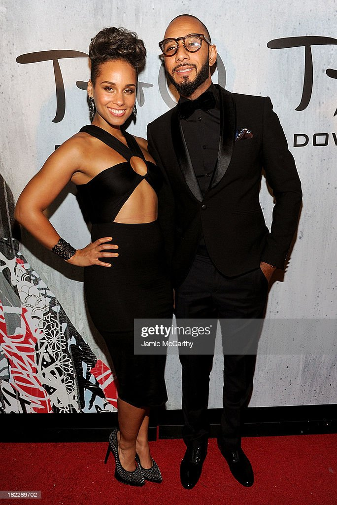 Alicia Keys (L) and Swizz Beatz attend TAO Downtown Grand Opening on September 28, 2013 in New York City.