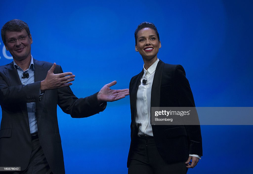 Alicia Keys, global creative director for Blackberry, right, smiles while being introduced by Thorsten Heins, chief executive officer of Research In Motion Ltd. (RIM), during the launch of the BlackBerry 10 in New York, U.S., on Wednesday, Jan. 30, 2013. Research In Motion Ltd., taking the name of its best-known product, will now be known simply as BlackBerry, part of a comeback plan that includes unveiling a redesigned line of smartphones today. Photographer: Scott Eells/Bloomberg via Getty Images