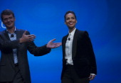 Alicia Keys global creative director for Blackberry right smiles while being introduced by Thorsten Heins chief executive officer of Research In...