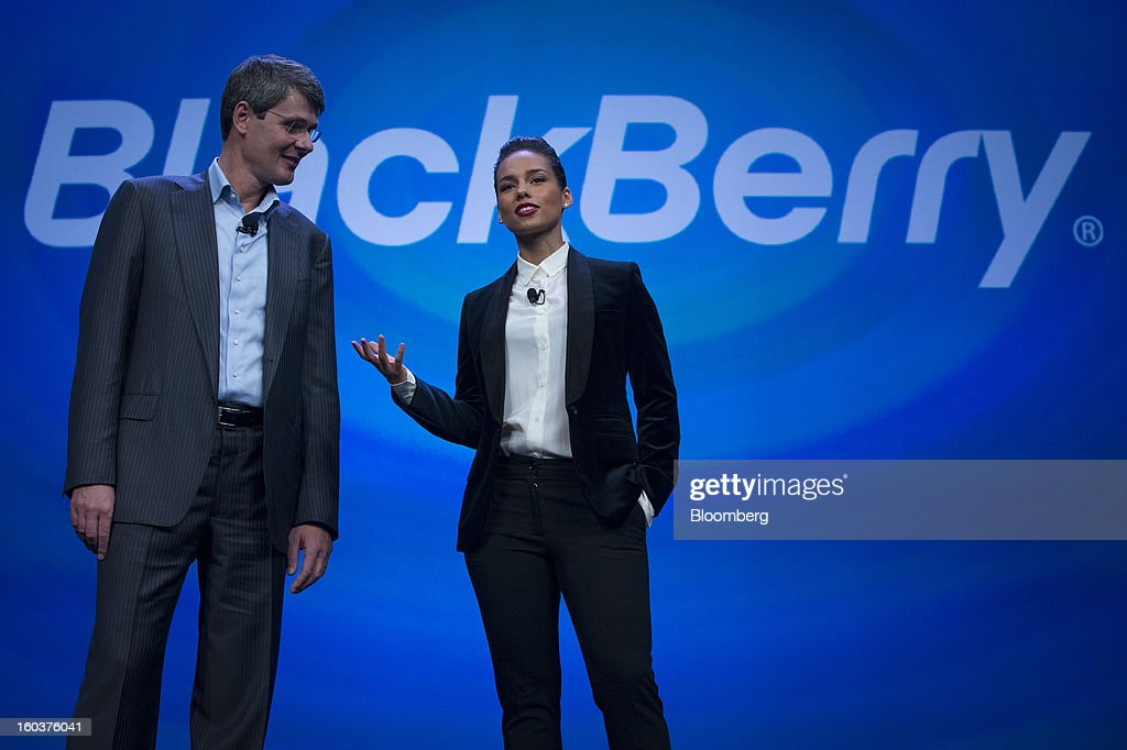 Alicia Keys, global creative director for Blackberry, right, speaks while Thorsten Heins, chief executive officer of Research In Motion Ltd. (RIM), listens during the launch of the BlackBerry 10 in New York, U.S., on Wednesday, Jan. 30, 2013. Research In Motion Ltd., taking the name of its best-known product, will now be known simply as BlackBerry, part of a comeback plan that includes unveiling a redesigned line of smartphones today. Photographer: Scott Eells/Bloomberg via Getty Images