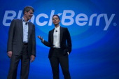 Alicia Keys global creative director for Blackberry right speaks while Thorsten Heins chief executive officer of Research In Motion Ltd listens...