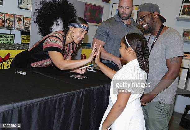 Alicia Keys greets a young fan during her album signing for 'Here' at Amoeba Music on November 11 2016 in Hollywood California