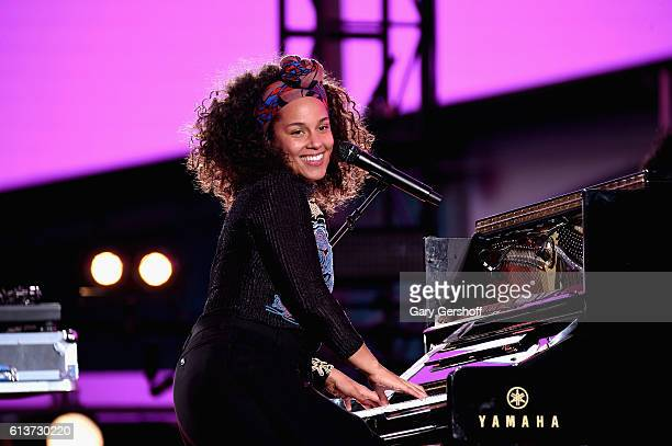 Alicia Keys performs in Times Square on October 9 2016 in New York City