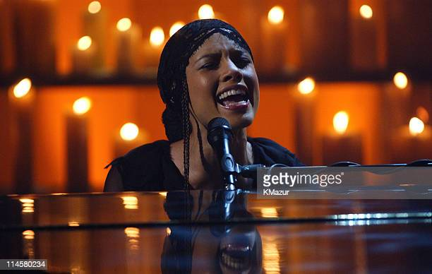 Alicia Keys performs 'Someday We'll All Be Free' on the live broadcast of 'America A Tribute To Heroes' in New York NY September 21 To make a...