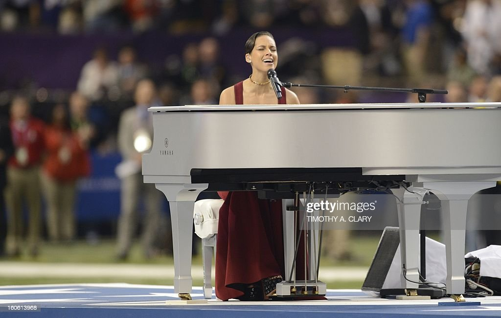 Alicia Keys performs the National Anthem before the start of Super Bowl XLVII between the San Francisco 49ers and the Baltimore Ravens at the Mercedes-Benz Superdome on February 3, 2013 in New Orleans, Louisiana.