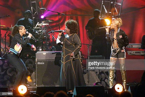 Alicia Keys performs with Angie Stone and Eve at the 2001 Billboard Music Awards at the MGM Grand Hotel and Casino in Las Vegas NV 12/4/01
