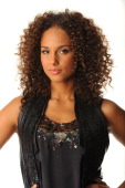 Alicia Keys poses in the portrait studio at the iHeartRadio Music Festival held at the MGM Grand Garden Arena on September 23 2011 in Las Vegas Nevada